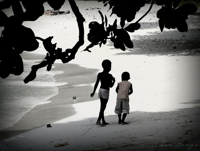 Boys playing at Champagne Beach, Santo